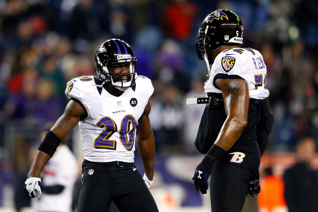 Description of . Tyrod Taylor #2 and Ray Lewis #52 of the Baltimore Ravens warms up prior to the 2013 AFC Championship game against the New England Patriots at Gillette Stadium on January 20, 2013 in Foxboro, Massachusetts.  (Photo by Jim Rogash/Getty Images)