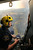 Westpac Police rescue helicopter crewman Sgt. Matthew Drumm surveys the fire near Dunalley, east of the Tasmanian capital of Hobart, Australia, on Saturday, Jan. 5, 2013.   Australian officials battled a series of wildfires amid scorching temperatures across the country on Saturday, with one blaze destroying dozens of homes in the island state of Tasmania. (AP Photo/Chris Kidd, Pool)