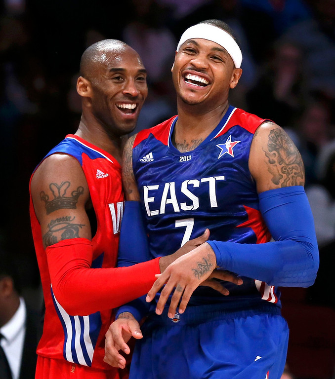Description of . NBA All-Star Kobe Bryant of the Los Angeles Lakers (L) and All-Star Carmelo Anthony of the New York Knicks laugh during the NBA All-Star basketball game in Houston, Texas, February 17, 2013.  REUTERS/Lucy Nicholson (UNITED STATES  - Tags: SPORT BASKETBALL)
