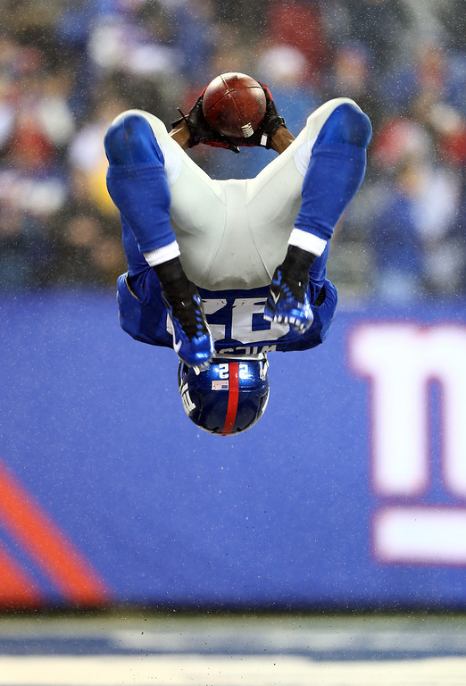 Description of . EAST RUTHERFORD, NJ - DECEMBER 09:  David Wilson #22 of the New York Giants celebrates his third touchdown of the game against the New Orleans Saints on December 9, 2012 at MetLife Stadium in East Rutherford, New Jersey.  (Photo by Elsa/Getty Images)