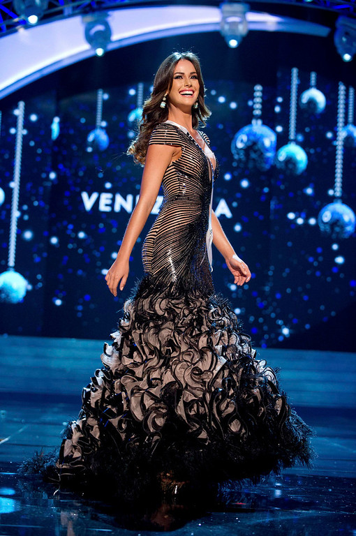 Description of . Miss Venezuela Irene Sofia Esser Quintero competes in an evening gown of her choice during the Evening Gown Competition of the 2012 Miss Universe Presentation Show at PH Live in Las Vegas, Nevada December 13, 2012. The 89 Miss Universe Contestants will compete for the Diamond Nexus Crown on December 19, 2012. REUTERS/Darren Decker/Miss Universe Organization/Handout