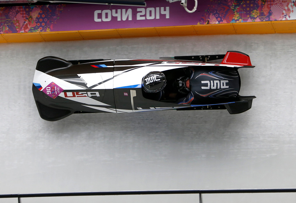 Description of . USA-3 driven by Nick Cunningham, left, with Dallas Robinson head down turn 11 during Heat 3 of the Two-man Bobsleigh at the Sliding Center Sanki for the 2014 Winter Olympics in Krasnaya Polyana, Russia on Monday, Feb. 17, 2014.  (Nhat V. Meyer/Bay Area News Group)