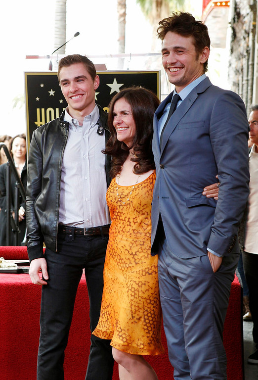 Description of . Actor James Franco (R) poses during ceremonies unveiling his star on the Hollywood Walk of Fame with his mother Betsy Lou Franco and brother Dave Franco (L) in Hollywood March 7, 2013. REUTERS/Fred Prouser