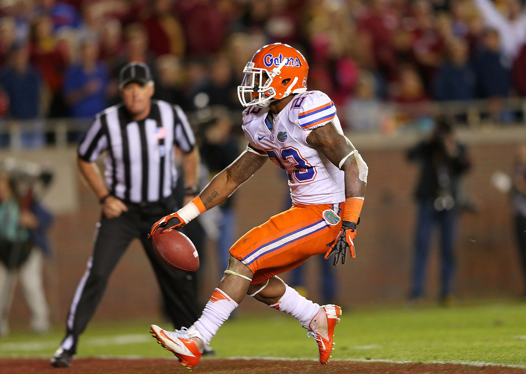 Description of . Mike Gillislee #23 of the Florida Gators scores a touchdown during a game against the Florida State Seminoles at Doak Campbell Stadium on November 24, 2012 in Tallahassee, Florida.  (Photo by Mike Ehrmann/Getty Images)