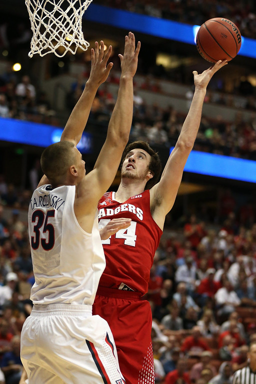 Description of . Frank Kaminsky #44 of the Wisconsin Badgers looks to shoot against Kaleb Tarczewski #35 of the Arizona Wildcats in the first half during the West Regional Final of the 2014 NCAA Men's Basketball Tournament at the Honda Center on March 29, 2014 in Anaheim, California.  (Photo by Jeff Gross/Getty Images)