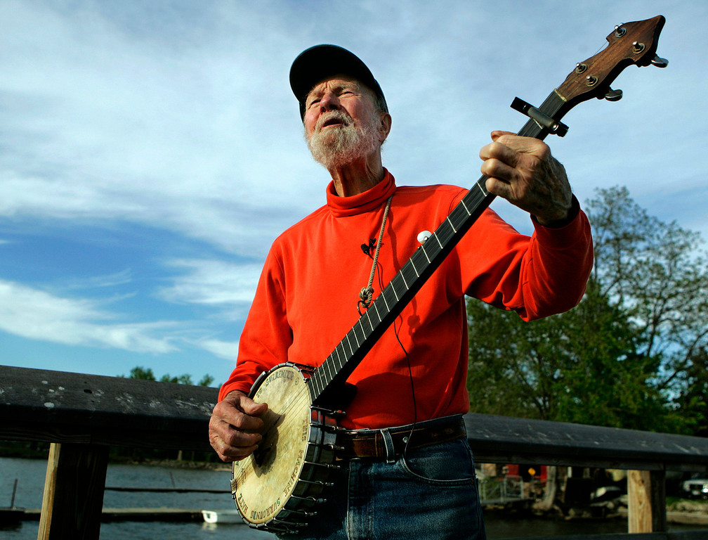 Description of . Pete Seeger plays his banjo Friday May 5, 2006 in Beacon, N.Y. The earnest troubadour who either co-wrote or popularized canonical songs like
