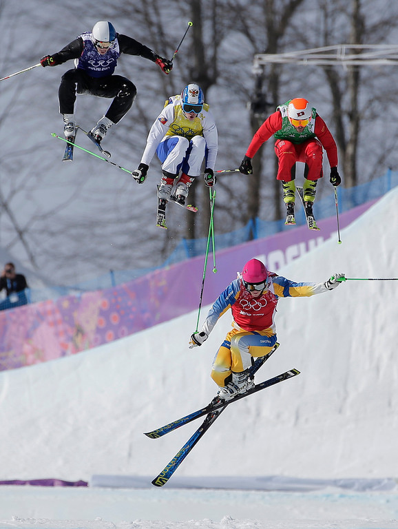 Description of . Sweden's Victor Oehling Norberg, bottom, loses his balance ahead of, from left,  Finland's Jouni Pellinen, Russia's Igor Korotkov and Switzerland's Armin Niederer during a men's ski cross heat at the Rosa Khutor Extreme Park, at the 2014 Winter Olympics, Thursday, Feb. 20, 2014, in Krasnaya Polyana, Russia. (AP Photo/Andy Wong)