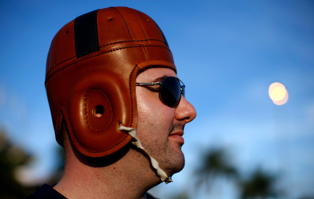 Description of . A Notre Dame Fighting Irish fan dressed in a vintage football helmet stands outside Sun Life stadium before the BCS National Championship college football game between the Alabama Crimson Tide and the Notre Dame Fighting Irish in Miami, Florida January 7, 2013. REUTERS/Mike Segar