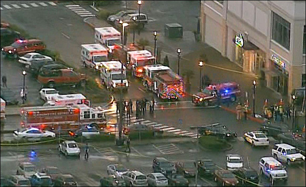 Description of . This still image from video courtesy of KATU.COM shows emergency vehicles after a shooting December 11, 2012 outside the Clackamas Town Center south of Portland, Oregon.   Two people were killed  when a gunman wearing body armor opened fire at a mall in the western US state of Oregon, witnesses and local media reported.  At least one other person was shot in Clackamas, south of Portland, according to The Oregonian newspaper, reporting a man brandishing a semiautomatic rifle near a branch of Macy's department store.     AFP PHOTO / KATU.COM