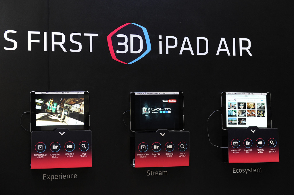 Description of . iPad Airs are displayed with EyeFly 3D screen protector film to create a 3D effect without the need for special glasses, at the 2014 International CES in Las Vegas, Nevada, January 8, 2014.  The iPad Air 3D will be available this month and is priced at USD $26.95.  The consumer electronics show, one of the largest in the world, runs from Jan 7-10. AFP PHOTO / ROBYN BECK/AFP/Getty Images
