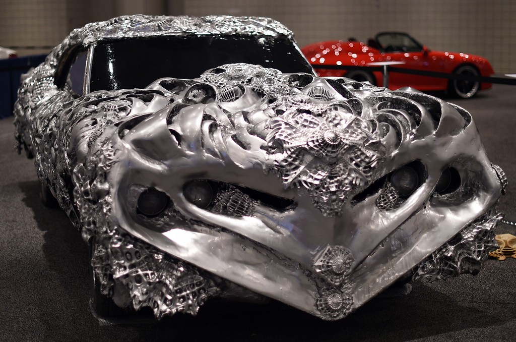 """. Artist Ioan Florea transformed the iconic muscle car, a Gran Torino, into a 3D piece of art by covering the car in a new metal surface with printed appliques is seen during the second press preview day at the 2014 New York International Auto Show  April 17, 2014 at the Jacob Javits Center in New York. AFP PHOTO / Timothy A. CLARY    == \""""/AFP/Getty Images"""