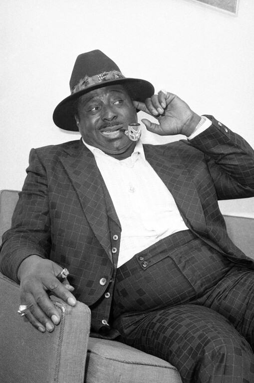 Description of . Blues Singer Albert King relaxes in his agent's midtown Manhattan office in New York on Nov. 8, 1976 where the 52-year-old entertainer spoke about the blues and the 30 years it took for him to make it. Despite the current disco sound Mania, king seems to the succeeding in putting the blues back in the mainstream of American music. His album is climbing the charts and he's making appearances to packed clubs and halls across the nation. (AP Photo/Ray Howard)