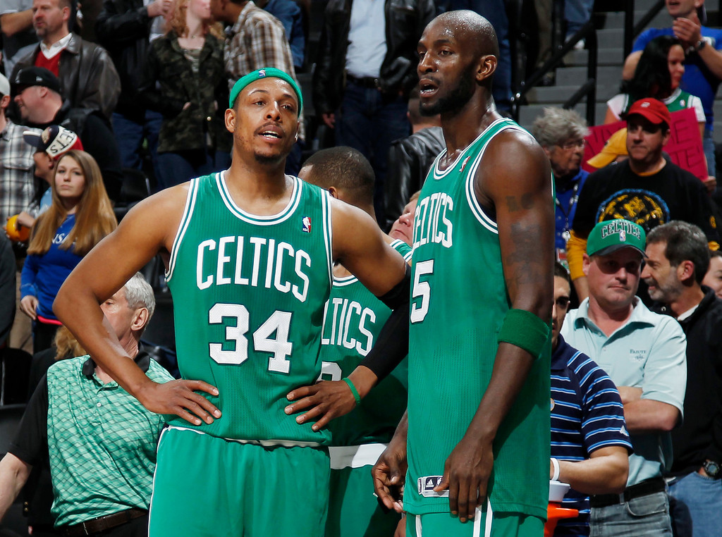 Description of . As time runs out, Boston Celtics forwards Paul Pierce, left, and Kevin Garnett wait to leave the floor in the Denver Nuggets' 97-90 victory over the Celtics in an NBA basketball game in Denver on Tuesday, Feb. 19, 2013. (AP Photo/David Zalubowski)