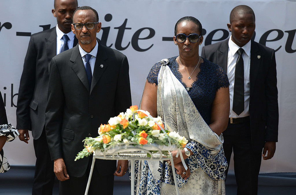 Description of . Rwanda's president Paul Kagame (L) and First Lady Janet Kagame lay a wreath of flower at the the Gizosi Genocide Memorial in Kigalia on April 7,2014. Solemn commemorations marking the 20th anniversary of Rwanda's genocide begins today and Kagame will light a flame that will burn for 100 days, the length of time it took government soldiers and