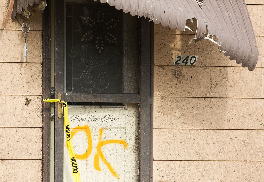 . A door is marked after it was searched by rescue workers Monday, June 16, 2014, in Pilger Neb. The National Weather Service said at least two twisters touched down within roughly a mile of each other. (AP Photo/The World-Herald, Ryan Soderlin)