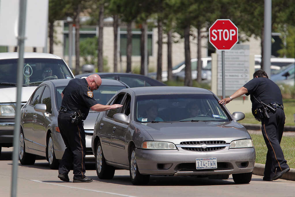 Description of . Harris County Sheriff's Deputies check vehicles leaving Lone Star College's Cypress-Fairbanks campus  Tuesday April 9, 2013  in Cypress, Texas.  (AP Photo/Houston Chronicle, James Nielsen)