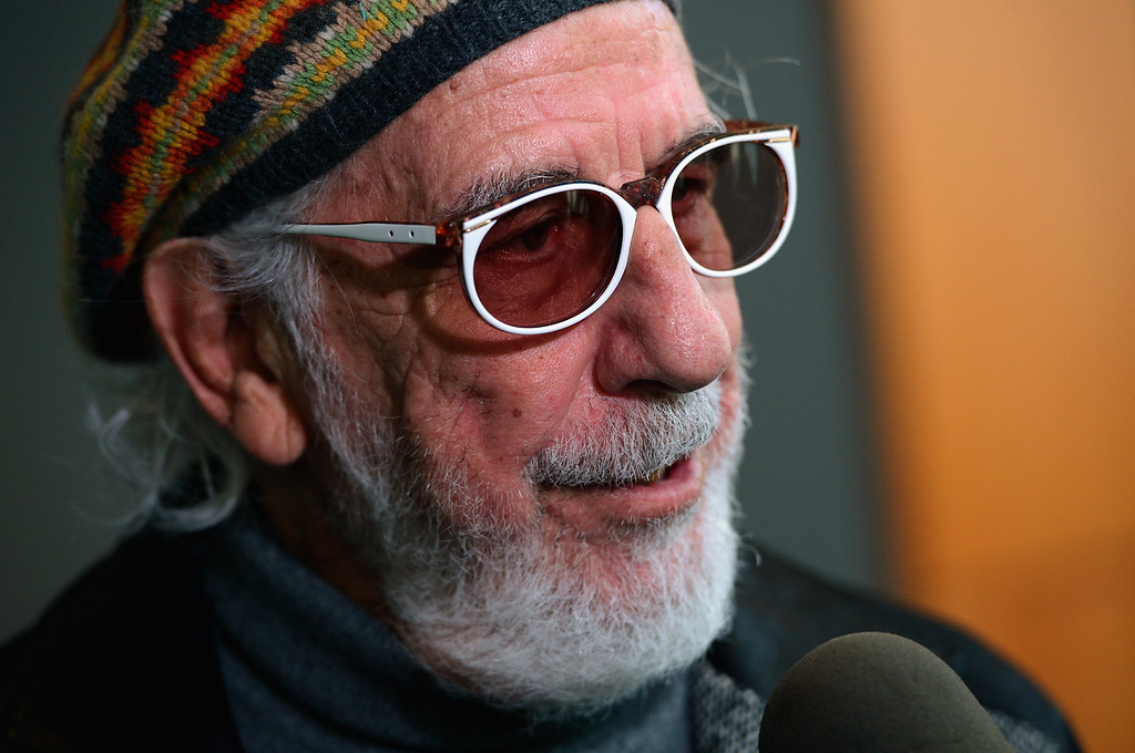 Description of . Record producer and Ahmet Ertegun Award recipient Lou Adler attends the press conference for the Rock and Roll Hall of Fame 2013 Inductees announcement at Nokia Theatre L.A. Live on December 11, 2012 in Los Angeles, California.  (Photo by Kevin Winter/Getty Images)