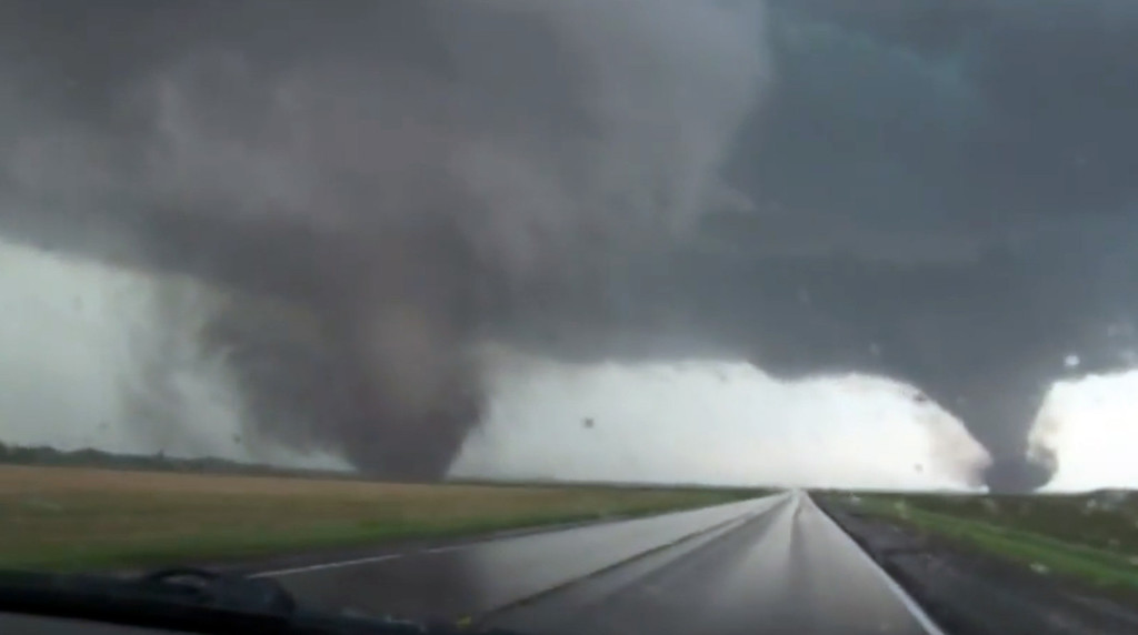 . This framgrab taken from video provided by StormChasingVideo.com shows two tornados approaching Pilger, Neb., Monday June 16, 2014.  The National Weather Service said at least two twisters touched down within roughly a mile of each other Monday in northeast Nebraska. (AP Photo/StormChasingVideo.com)