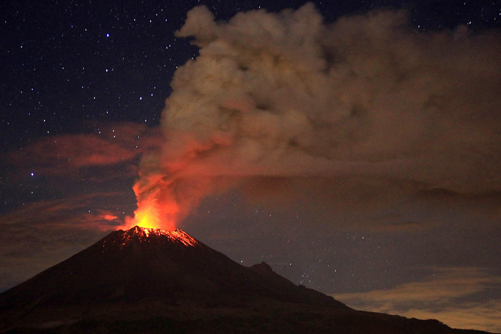 Description of . Ash spews from Mexico's Popocatepetl volcano near Mexico City, as seen from San Mateo Ozolco, in the Mexican central state of Puebla, on July 4, 2013.  Pablo Spencer/AFP/Getty Images