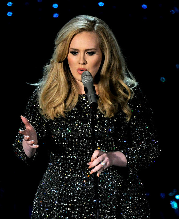 Description of . Singer Adele performs during the Oscars at the Dolby Theatre on Sunday Feb. 24, 2013, in Los Angeles.  (Photo by Chris Pizzello/Invision/AP)