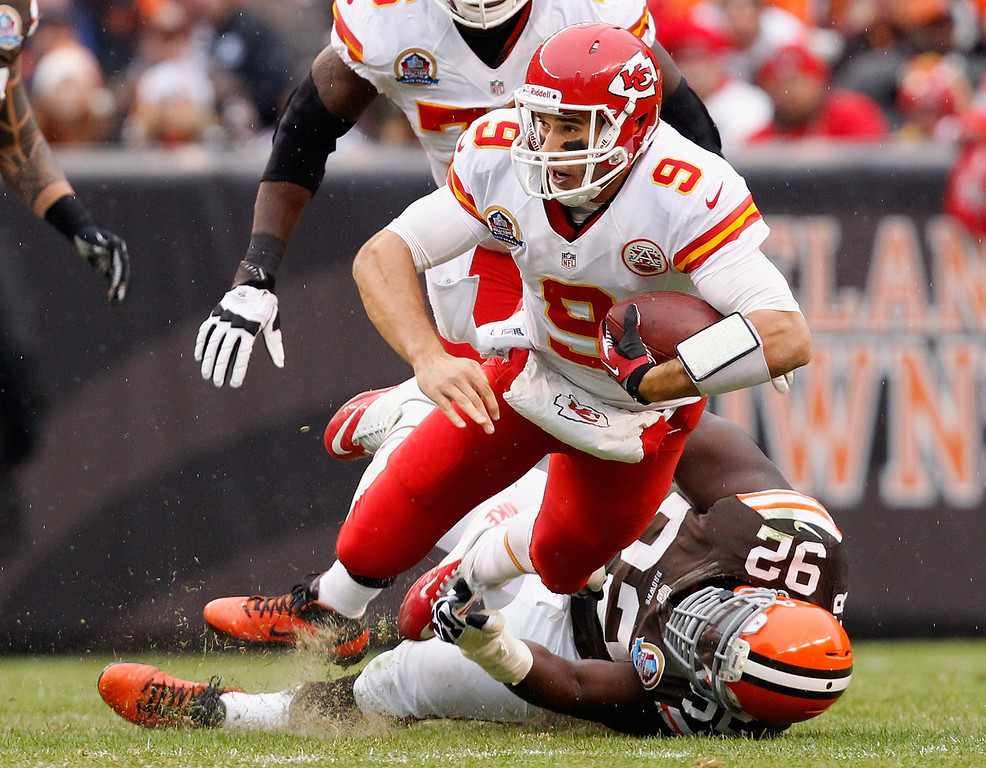 Description of . CLEVELAND, OH - DECEMBER 09:  Quarterback Brady Quinn #9 of the Kansas City Chiefs is sacked by defensive lineman Frostee Rucker #92 of the Cleveland Browns at Cleveland Browns Stadium on December 9, 2012 in Cleveland, Ohio.  (Photo by Matt Sullivan/Getty Images)