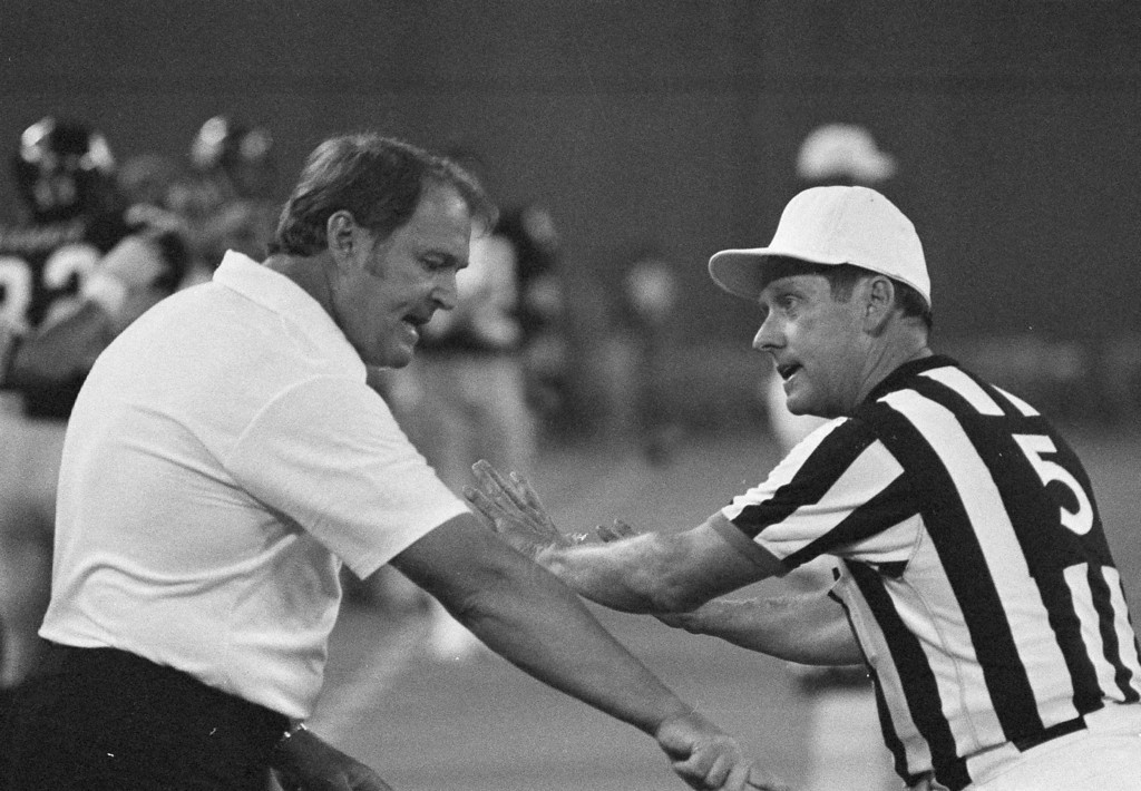 Description of . Pittsburgh Steelers head coach Chuck Noll discusses a holding call with NFL official Ray Douglas in the fourth quarter of the Steelers' game with the Atlanta Falcons Saturday, Aug. 13, 1978 in Pittsburgh. On the disputed play a Steelers touchdown was called back because of a holding call on Bennie Cunningham. Douglas won the argument. Noll's team won the game, scoring the winning touchdown on the next play, a touchdown pass to Lynn Swann. (AP Photo/Stewart)