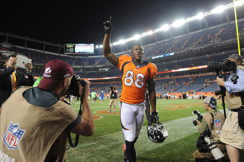 Description of . Denver Broncos wide receiver Demaryius Thomas (88) walks off the fielsd after  the Broncos defeated the Ravens 49-24. Denver Broncos Baltimore Ravens September 5, 2013 at Sports Authority at Mile High. (Photo by Joe Amon/The Denver Post)