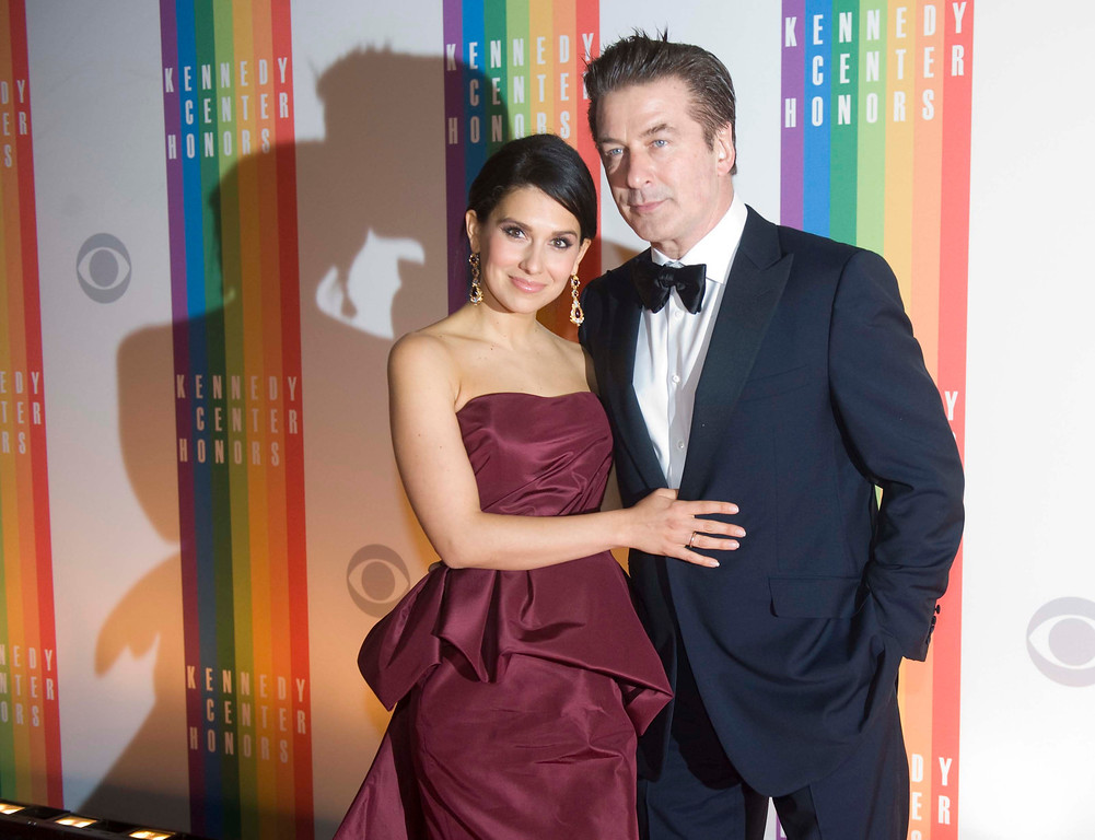 Description of . Actor Alec Baldwin and wife, Hilaria, arrive at the Kennedy Center for the Performing Arts for the 2012 Kennedy Center Honors Performance and Gala, Sunday, Dec. 2, 2012 at the State Department in Washington. (AP Photo/Kevin Wolf)
