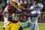 Washington Redskins running back Alfred Morris (46) is tackled by Dallas Cowboys strong safety Eric Frampton (27) during the second half of an NFL football game Sunday, Dec. 30, 2012, in Landover, Md. (AP Photo/Richard Lipski)