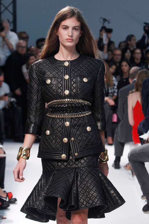 Description of . A model wears a creation for Balmain ready-to-wear Spring/Summer 2014 fashion collection, presented in Paris, Thursday, Sept.26, 2013. (AP Photo/Thibault Camus)