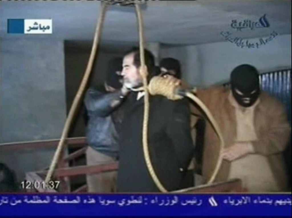 Description of . In this television screen grab taken from Iraqi national television station Al-iraqia, a video shows the moments leading up to the execution of former Iraqi dictator Saddam Hussein as he was prepared for hanging and the noose is put over his head on the gallows, on December 30, 2006 in Baghdad, Iraq. The former Iraqi president was executed by hanging at 0600 (0300 GMT) in a secure facility in the Northern Baghdad suburb of Khadimeya. (Photo by Al-iraqia via Getty Images)