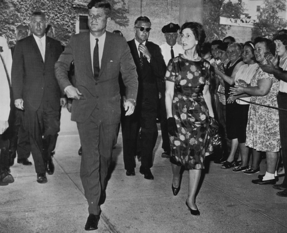 Description of . The president, accompanied by Mrs. Hugh D. Auchincloss, the first lady's mother, arrives at a  hospital in Boston to check on the progress of his newborn son, Patrick, on August 9, 1963.