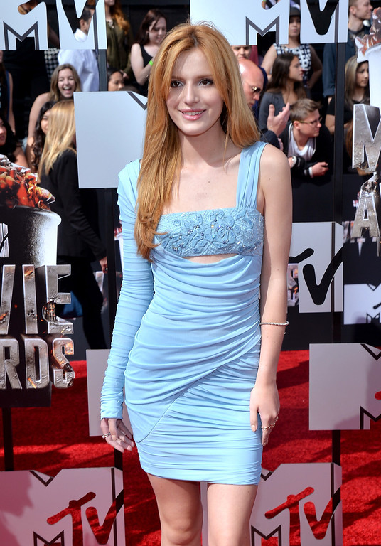 Description of . Actress Bella Thorne attends the 2014 MTV Movie Awards at Nokia Theatre L.A. Live on April 13, 2014 in Los Angeles, California.  (Photo by Michael Buckner/Getty Images)