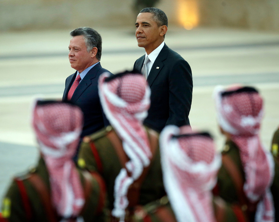 Description of . President Barack Obama and Jordan's King Abdullah II, participate in an arrival ceremony at the King's Palace in Amman, Jordan Friday, March 22, 2013. (AP Photo/Pablo Martinez Monsivais)