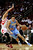 Denver Nuggets' Danilo Gallinari (8) drives the ball around Houston Rockets' Chandler Parsons, left, in the first half of an NBA basketball game Wednesday, Jan. 23, 2013, in Houston. (AP Photo/Pat Sullivan)