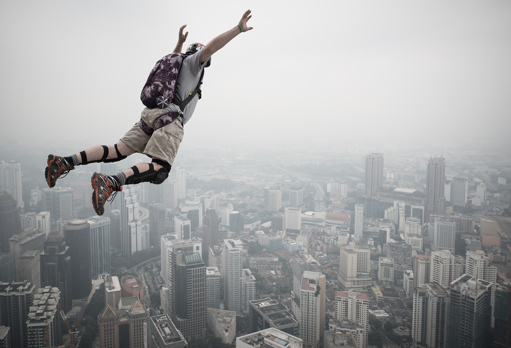 Description of . Base jumper Peter Andexlinger from the US leaps from the 300-meters Open Deck of the Malaysia's landmark Kuala Lumpur Tower during the International Tower Jump in Kuala Lumpur on September 27, 2013.    AFP PHOTO / MOHD RASFAN/AFP/Getty Images