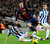 Barcelona's Lionel Messi (C) fights for the ball with Espanyol's Diego Colotto (L) during their Spanish First division soccer league match at Camp Nou stadium in Barcelona January 6, 2013. REUTERS/Sergio Carmona