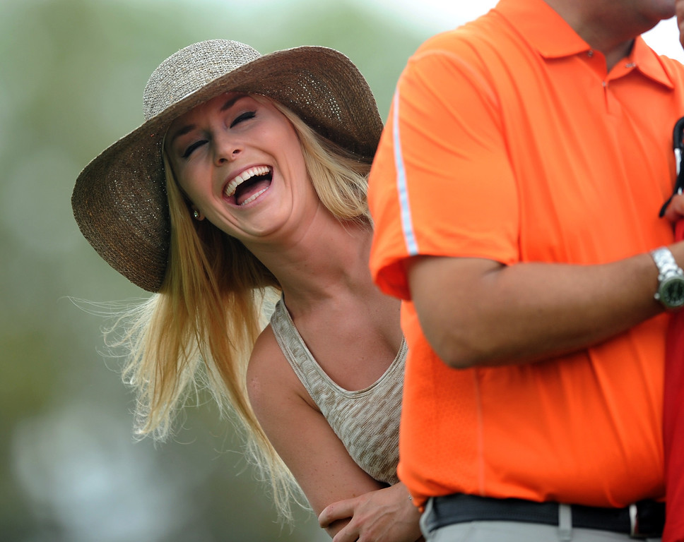 Description of . US Olympic skier Lindsey Vonn watches Tiger Woods of the US during the first round of the 77th Masters golf tournament at Augusta National Golf Club on April 11, 2013 in Augusta, Georgia.  JIM WATSON/AFP/Getty Images