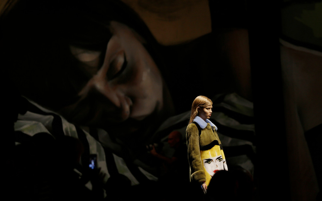 Description of . A model wears a creation for Prada's women's Spring-Summer 2014 collection, part of the Milan Fashion Week, unveiled in Milan, Italy, Thursday, Sept. 19, 2013. (AP Photo/Luca Bruno)