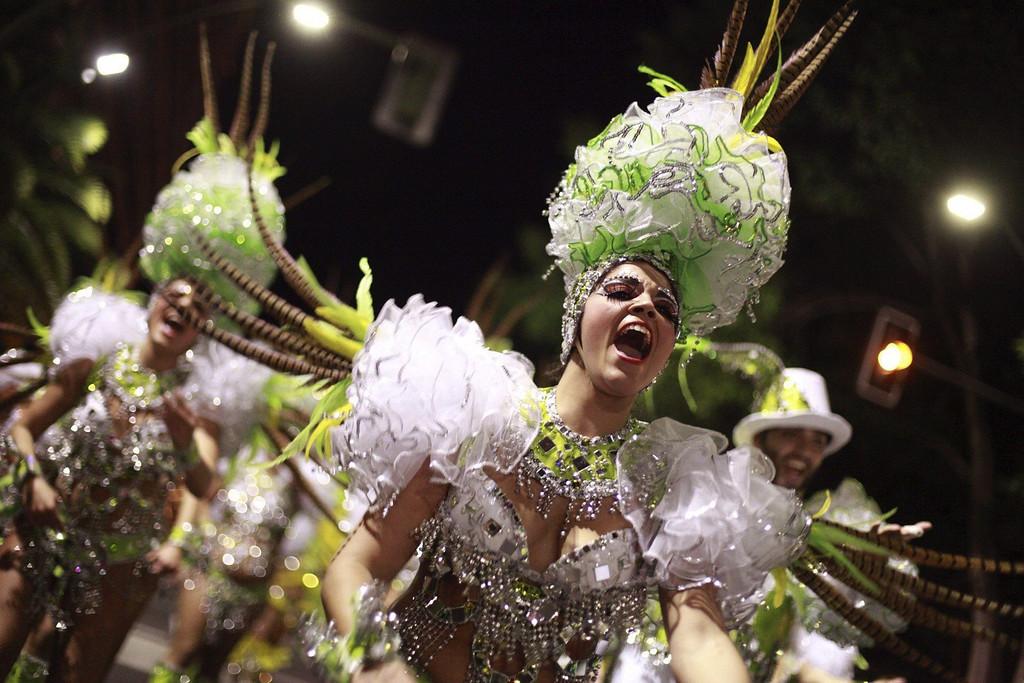 Description of . Members of dancing group 'Cariocas' perfom during a carnival parade in Santa Cruz de Tenerife, Canary Islands, Spain, 01 March 2014.  EPA/RAMON DE LA ROCHA