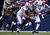 James Laurinaitis #55 of the St. Louis Rams picks up a fumble during an NFL game as he is tackled by David Snow #61 of the Buffalo Bills after teh Bills turned the ball over at Ralph Wilson Stadium on December 9, 2012 in Orchard Park, New York. (Photo by Tom Szczerbowski/Getty Images)