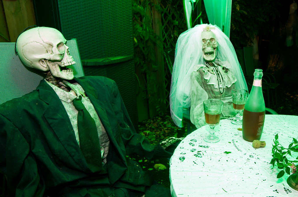 Description of . Two skeletons dressed for a wedding sit in a garden of the Horn family house in Isernhagen,Germany, on October 28, 2013. The Horn family has been decorating their house for Halloween for more than ten years.  CHRISTIAN DITTRICH/AFP/Getty Images