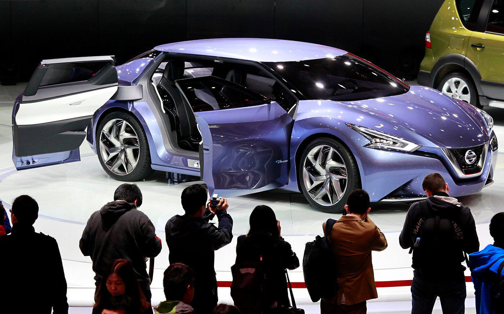Description of . Guests view a prototype car from Nissan during the opening day of the 15th Shanghai International Automobile Industry Exhibition in Shanghai April 20, 2013. China's premier auto show opened in Shanghai on Saturday, with global and local automakers showcasing new models, technologies and strategies. China is the world's biggest autos market and - while growth has slowed from its blistering pace of recent years - is a key battleground for an industry that has stuttered in the U.S. and Europe.  REUTERS/Aly Song