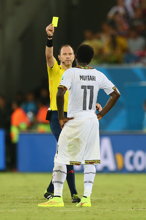 Description of . NATAL, BRAZIL - JUNE 16:  Sulley Muntari of Ghana is shown a yellow card by referee Jonas Eriksson during the 2014 FIFA World Cup Brazil Group G match between Ghana and the United States at Estadio das Dunas on June 16, 2014 in Natal, Brazil.  (Photo by Kevin C. Cox/Getty Images)