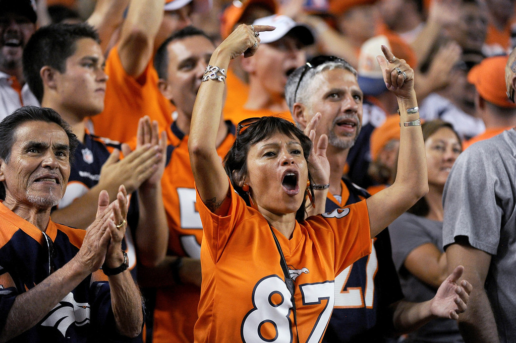 Description of . Denver Broncos fans cheer a touchdown during the third quarter. Denver Broncos vs Baltimore Ravens September 5, 2013 at Sports Authority at Mile High. (Photo by Tim Rasmussen/The Denver Post) /The Denver Post)
