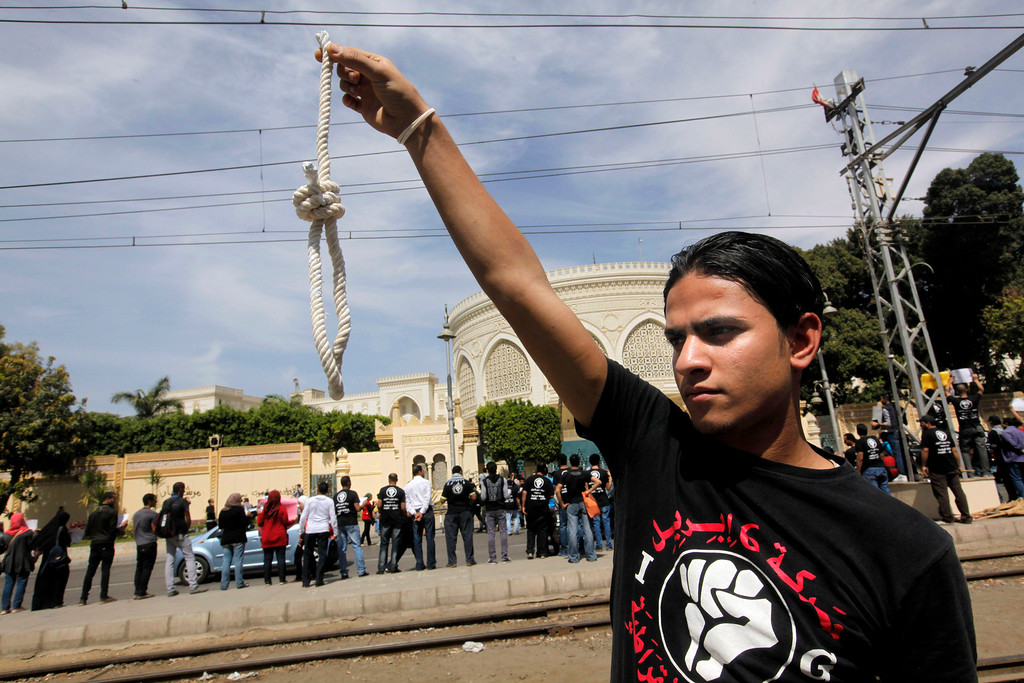 Description of . A member of Egyptís April 6 Youth Movement holds a noose in front of the presidential palace in Cairo, Egypt, Saturday, April 6, 2013. The group is rallying to mark its fifth anniversary and to protest against President Mohammed Morsi. (AP Photo/Amr Nabil)