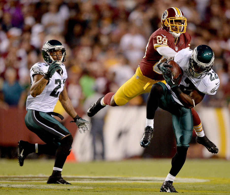Description of . Cornerback Brandon Boykin #22 of the Philadelphia Eagles intercepts a pass in front of wide receiver Santana Moss #89 of the Washington Redskins in the first quarter at FedExField on September 9, 2013 in Landover, Maryland.  (Photo by Patrick Smith/Getty Images)