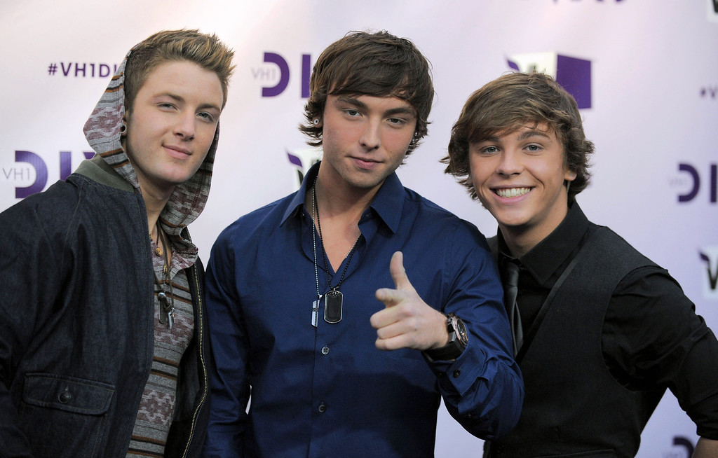 Description of . From left, Drew Chadwick, Wesley Stromberg and Keaton Stromberg, of musical group Emblem3, arrive at VH1 Divas on Sunday, Dec. 16, 2012, at the Shrine Auditorium in Los Angeles. (Photo by Jordan Strauss/Invision/AP)