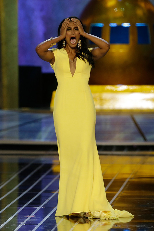 Description of . Miss New York Nina Davuluri reacts after being named Miss America 2014, Sunday, Sept. 15, 2013, in Atlantic City, N.J. (AP Photo/Mel Evans)