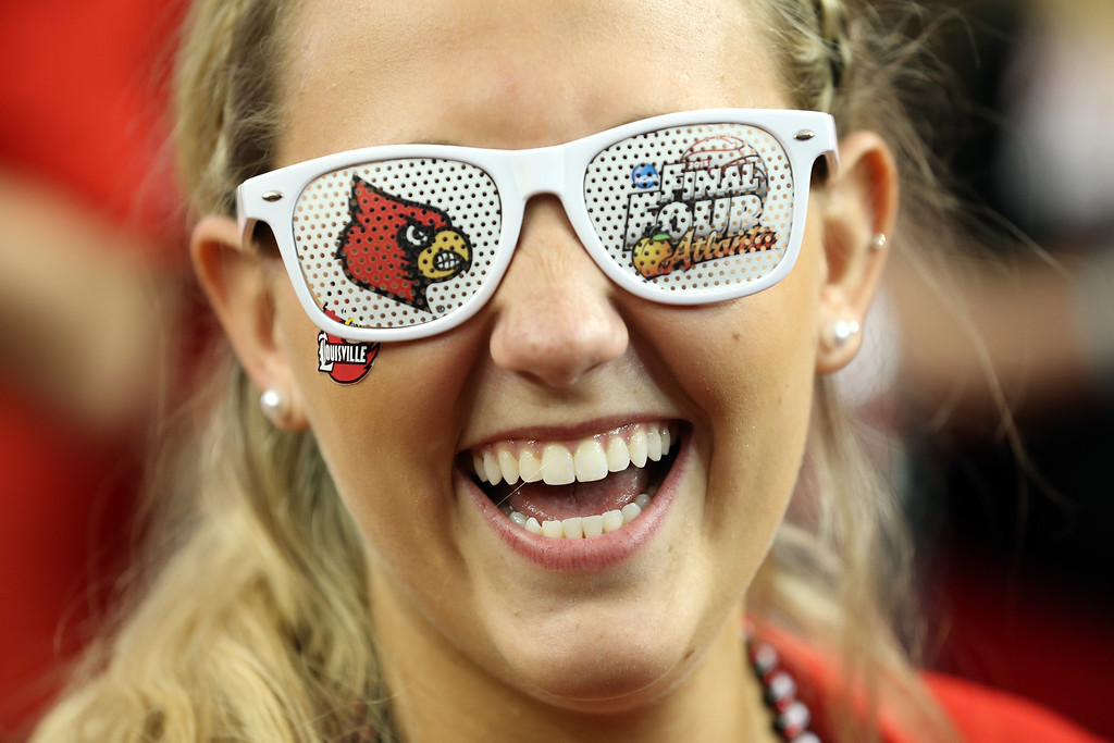 Description of . ATLANTA, GA - APRIL 06:  Allie Funk, a Louisville Cardinals fan, poses before the Cardinals take on the Wichita State Shockers in the 2013 NCAA Men's Final Four Semifinal at the Georgia Dome on April 6, 2013 in Atlanta, Georgia.  (Photo by Andy Lyons/Getty Images)